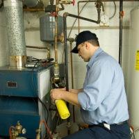 man replacing furnace