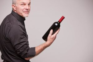 man holding wine bottle
