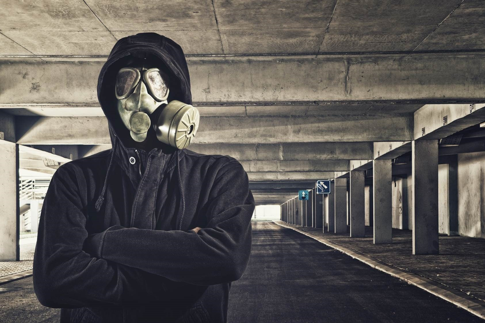Man With Gas Mask In Public Garage
